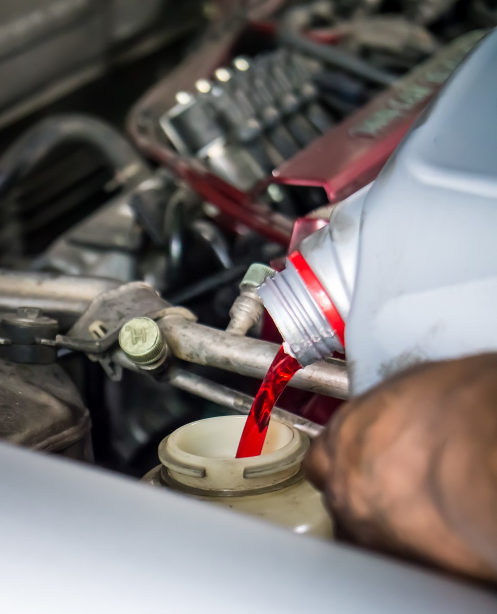 transmission fluid being poured into vehicle